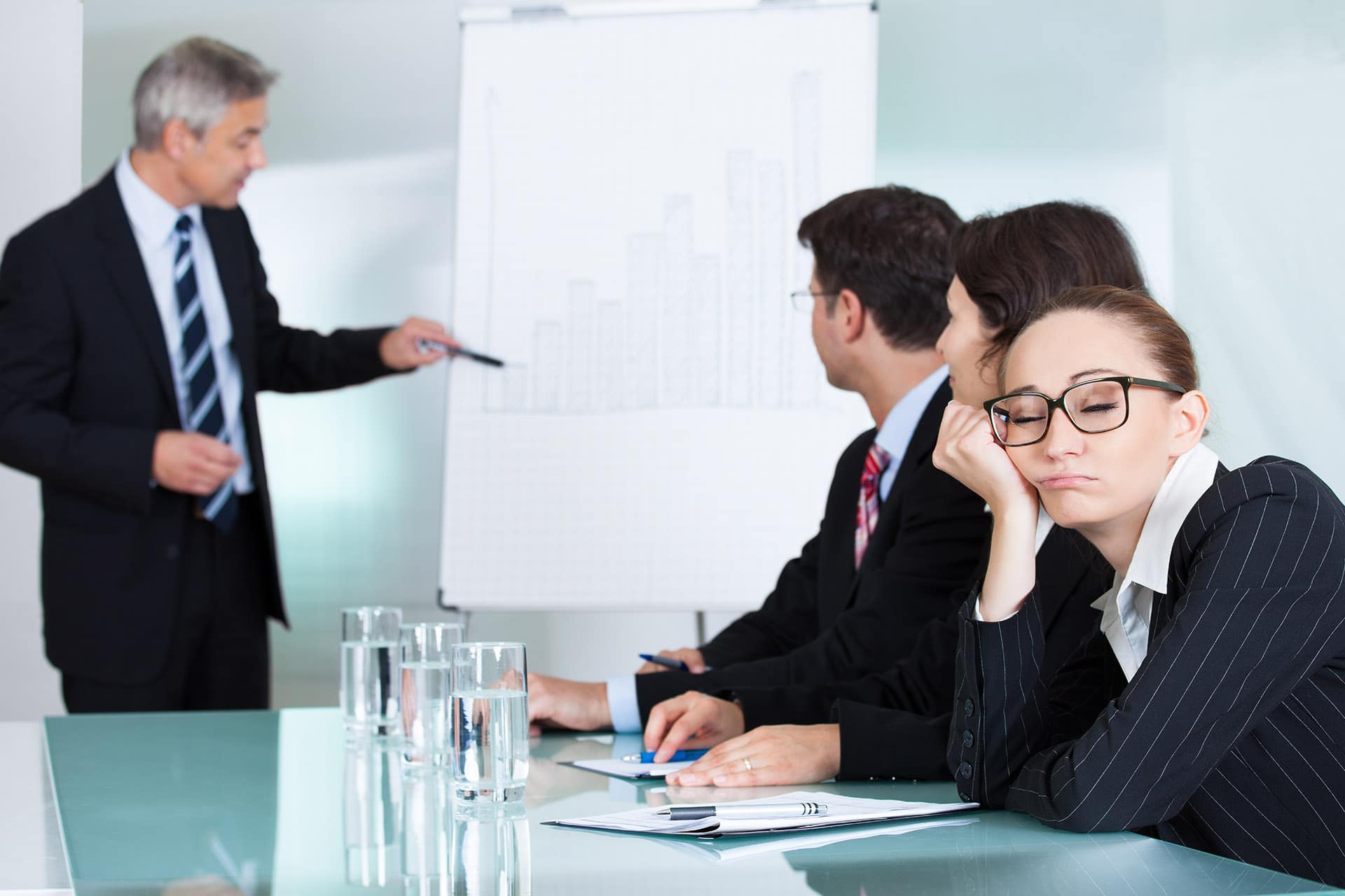 Woman Falling Asleep During a Presentation